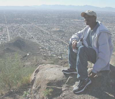 Kipng'etich takes in the view from Shaw Butte looking south towards